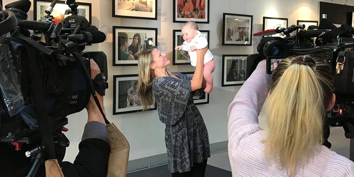 Mother and baby with News crew