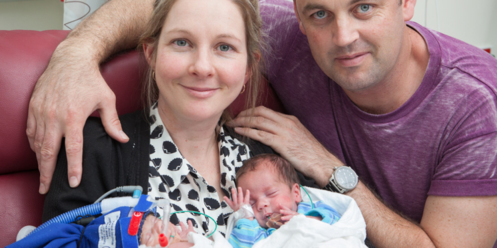 Rachael Sutton and Mark Kerville with twin sons, Sam and Ethan, now six months old.