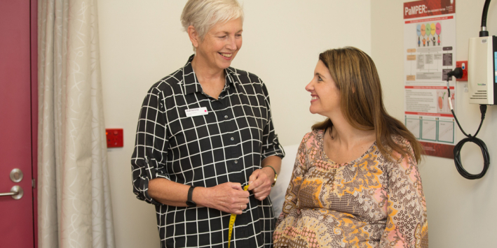Research midwife Adrienne White (L) with patient
